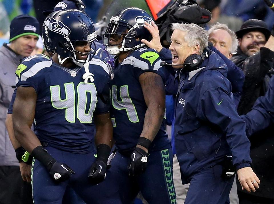Marshawn Lynch (140 rushing yards, 2 TDs) got a hand from coach Pete Carroll after Lynch rumbled 31 yards to give the Seahawks a 23-8 lead in the fourth quarter.